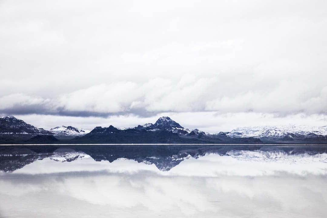 lake flow snowy mountains
