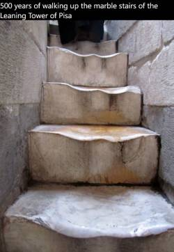 500 years of walking up the marble stairs of the Leaning Tower of Pisa
